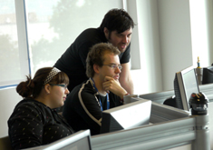 Photo of students looking at a computer screen