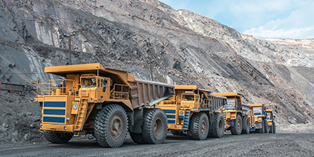 Photos of trucks in an open pit mine
