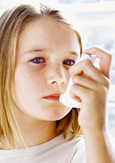 Photo of a child using an asthma inhaler