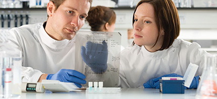 Photo of two technicians working in a laboratory