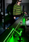 Photo of a laboratory technician conducting optics-photonics tests