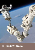 Photo of an astronaut in space at the tip of Canadarm2, courtesy of NASA