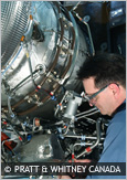 Photo of technician repairing an aircraft engine
