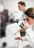 Photo of two biochemists in a lab