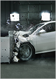 Photo of a frontal crash of a car in a crash test facility