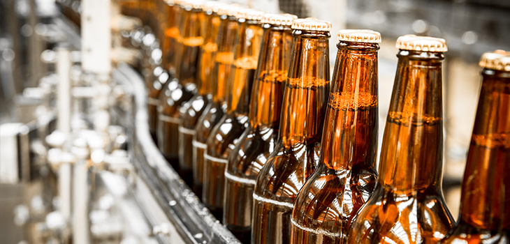 Photo of bottles of beer on a conveyor in a bottling plant