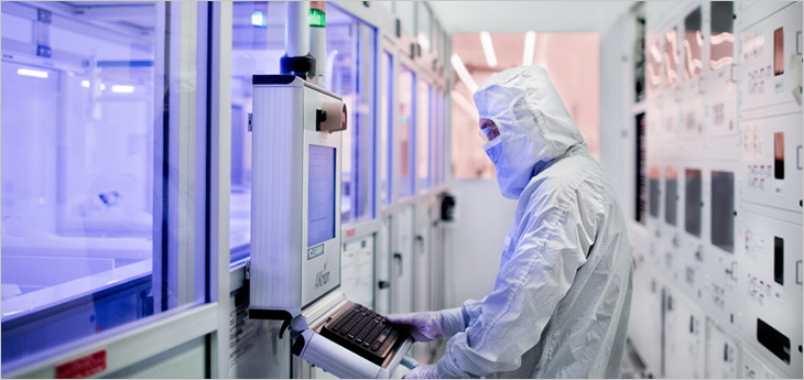 Photo of a technician in a C2MI research lab