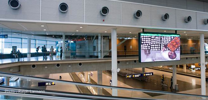 Photo of an LED billboard at the Montréal airport. Photo courtesy of Ralph Larmann