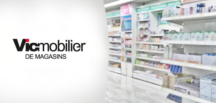 Photo concept : présentoir dans une pharmacie avec le logo de l'entreprise Vic Mobilier