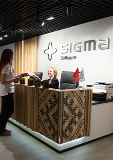 Photo of a person at the reception desk of a Sigma Software office