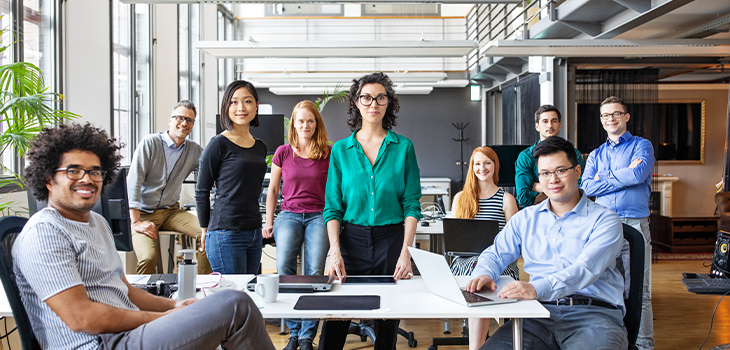 Photo of young professionals in a company