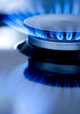 Close-up of blue flames from a gas burner