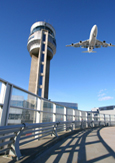 Photo of a jet taking off near the Montréal-Trudeau Airport control tower