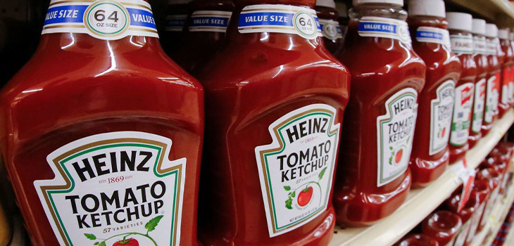 Heinz Ketchup bottles on a shelf in a grocery store