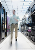 Photo of a man walking in a server room