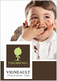 Photo of a child enjoying chocolate along with the Theobroma Chocolat logo