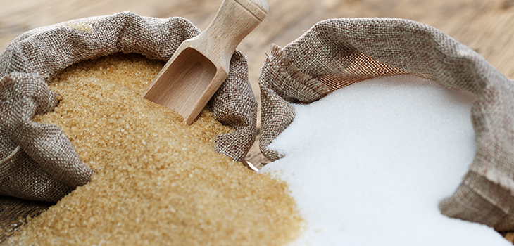Photo of  various types of sugar, brown sugar and white