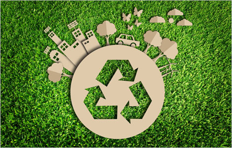 Icone de recyclage incrustée dans une représentation de la Terre