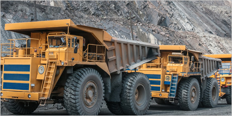 Photo of trucks in an open pit mine
