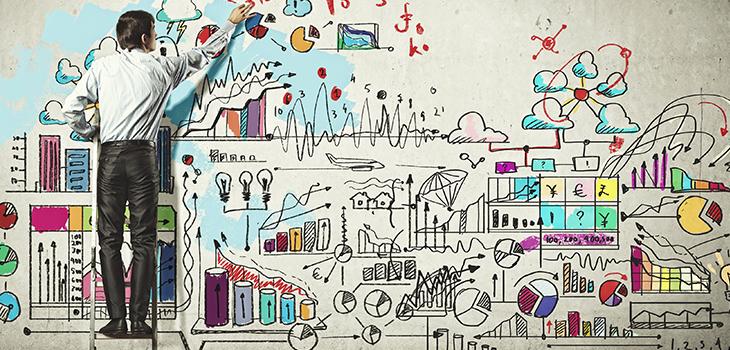 Vue en arrière-plan d'un homme d'affaires dessinant sur un mur